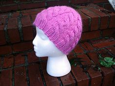 Perfect for a quick present or an instant gratification project. It only uses one skein of bulky yarn and works up in a snap on size 10.5 needles. The decreases are carefully constructed to run cables all the way to the top of the hat.