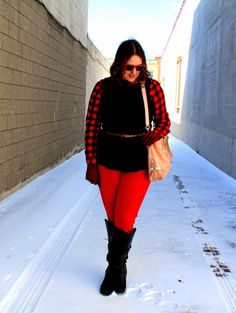 Dressing for cold weather.  Red buffalo plaid, red pants, black peplum top and black knee high boots