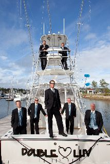 Groomsmen on boats = nautical wedding perfection! @River Dunes { Photo by McCardell Photography }
