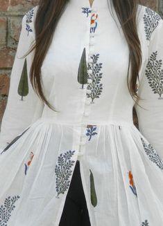 Designer long cape in white with mutli blocks in various colours. Designer dress has mandarin collar. Buy designer dresses at Dvibgyor. Simple Pakistani Dresses, Indian Gowns Dresses, Pakistani Dress Design, Simple Kurta Designs, Stylish Dress Designs, Stylish Dresses, Stylish Outfits, Indian Designer Outfits, Designer Dresses