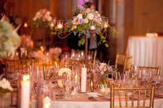 Our gorgeous tablescapes done by LaFleur Plantscapes! We really loved the look of the candelabras with the additional low elements. The gold chiavari chairs were perfect with our decor.   Photo credit: Sarah Neyhart Photography