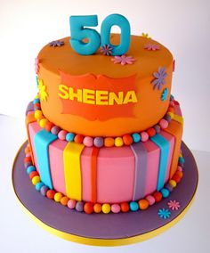 My sugar coated life...: Bright and funky 50th birthday cakes with orange, pink and purple colours via Star Bakery http://www.starbakery.co.uk/
