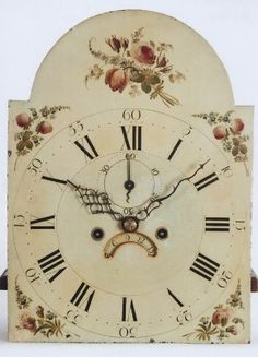 This dial is colorfully paint decorated. Interestingly, this dial lacks the raised gesso worked that is traditionally found on imported dials from this period. This gesso work is often located in the borders of the spandrel areas and in the decoration found in the arch. As a result, the florals are presented in a slightly more free flowing approach. The time ring features Roman hour numerals. Arabic five minute markers are positioned above each hour.