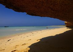 Beach on Dahlak islands, Eritrea  •  The only shadow is provided by the coral platforms
