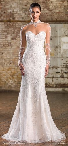 Beaded illusion tulle Mandarin neckline, illusion back neckline, and sleeves, adorn this allover beaded tulle and lace fit and flare gown with a chapel length train.