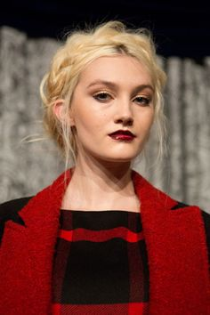 Fluffy, voluminous take on milkmaid braids, created by Antonio Corral Calero for Moroccanoil at the Alice + Olivia presentation. The dark, vampy lip combined with the devil-may-care texture takes the Heidi connotations out of this classic style.