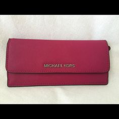 """Brand NWT Michael Kors Jet Set Travel Flat Wallet Brand New With Tag Michael Michael Kors Flat Wallet Color: Deep Pink  Item# 32F3STVE7L  Details: Saffiano Leather 8 Credit card pockets 2 divisions inside (1 main compartment & 1 long slip pocket) See Pictures Snap closure Size: approx. 7.5"""" x 3.5"""" Michael Kors Bags Wallets"""