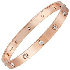 Cartier Love Bracelet Rose Gold With 10 Diamonds Size 17 New Screw System So the screw cannot fall out. This Bracelet is in Mint condition. Comes With Box and Screw Driver Guaranteed Authentic Cartier Antique Bracelets, Diamond Bracelets, Love Bracelets, Sterling Silver Bracelets, Jewelry Bracelets, Ankle Bracelets, Silver Earrings, Indian Earrings, Silver Ring