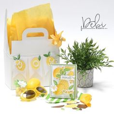 """No matter the weather, bring a """"Box of Sunshine"""" to someone special. Guaranteed you get blessed too! Tutorial is up on my blog today. #boxofsunshine #nomattertheweather #kindnessmatters #thecontainerstore #justbecause #happy #yellow #lemons #treats #card #diecuts #banner #papercraft #neverstopmaking #teamspellbinders"""