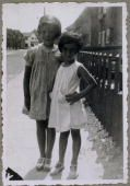 July 1934: EXCLUSIVE A full-length portrait of Anne Frank (1929 - 1945), (right) and an unidentified girlfriend standing next to each other on a sidewalk. From Anne Frank's photo album. (Photo by Anne Frank Fonds/Anne Frank House via Getty Images)