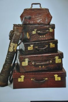 imagine going on a train or some sort of expedition with all this lovely luggage ~ even one for the golf clubs!
