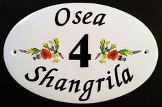 Large Oval House Sign with flowers left and right of house number. See more of our signs with flowers and trees on our website www.handpaintedhousesigns.co.uk