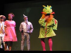 The Wiz! The GateKeeper was a hoot!. She wore a simple shift with wired hem. Her hat and feathered eyeglasses made the look. She represented an African Secretary Bird. Love the legs!