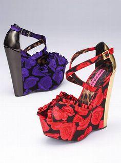 "Betsey Johnson  Britt Platform Wedge Sandal        * Covered platform and heel      * Criss-cross ankle straps with adjustable buckle      * 5"" wedge heel with 1 1/2"" platform      * Imported satin  $129.00"