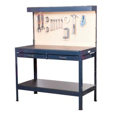 This sturdy multi-purpose workbench has a built-in cabinet light and a outlet for your tools. The workbench has plenty of storage space with a peg board, two drawers, and top and bottom shelves. Durable steel construction with composite wood table top. Tool Storage, Storage Shelves, Storage Spaces, Garage Storage, Industrial Workbench, Diy Workbench, Garage Workshop Organization, Organization Ideas, Storage Ideas