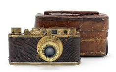 A rare, gold-plated Leica Luxus II camera will be sold at an auction in Hong Kong on 22 November Although the camera is valued between. Leica Camera, Leica Digital Camera, Camera Rig, Pinhole Camera, Camera Gear, Camera Phone, Antique Cameras, Vintage Cameras, Best Underwater Camera