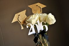 Confetti Mommas Graduation Centerpiece is so sophisticated and chic! Use these graduation cap and 2016 wands alone in a vase or pair them with