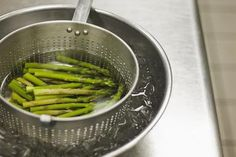 Asparagus cooling in ice water - Jetta Productons/David Atkinson/Getty Images