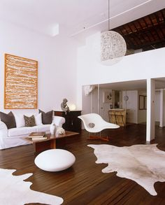 White Modern Living Room with cool large art piece