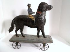 Early American Tin Jockey on Large Dog