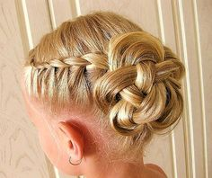 These side french braids gather to the back to form a design reminiscent of a Celtic Knot.