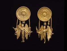 dreamsofsilverandgold: Eros earrings Date: late 4th century B.C. Dimensions: Height: 2 1/8 in. (5.398 cm) Diameter: 7/8 in. (2.223 cm) Medium: Gold Credit Line: Dallas Museum of Art, Cecil and Ida Green Acquisition FundCulture: Greek