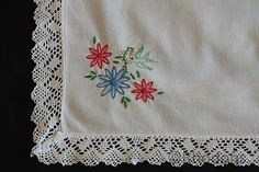 Pretty linen & lace Tablecloth with hand embroidered poppies, flowers & birds to the corners. Square shaped with crochet lace edging. Believed to date circa 1950/60's
