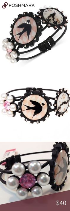 """NWT BETSEY JOHNSON WONDERLAND COLLECTION BRACELET NWT BETSEY JOHNSON WONDERLAND COLLECTION HINGED BANGLE BRACELET   RETAIL PRICE: $65.00  •CAMEO MEDALLION  •FAUX PEARL FLOWER WITH PINK CRYSTAL •BLACK RAVEN BIRD IN FLIGHT •CLOCK ENCASED IN PEACH •MAGNETIC HINGED CLOSURE •PINK & PEACH CRYSTALS •STANDARD BANGLE  •DIAMETER 2.5"""" •BLACK MIXED METAL  **SOLD OUT EVERYWHERE - RARE & RETIRES*** Betsey Johnson Jewelry Bracelets"""