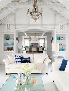 No original source but I love the wood beams and the colors used in this room. Beautiful, bright and airy!