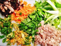 Chopped vegies ready for San Choy Bow. A great way to smuggle loads of vegetables into kids, mushroom, carrot, corriander, water chesnuts, celery, green beans. San Choy Bow is a (guilt free) healthy, low carb dinner. The contrast of cold crunch delicately housing the hot juicy meat inside is the signature of the dish. A veggie smugglers dream, and elbow wetting family favorite. http://www.eatraiselove.com/eat/san-choy-bow/
