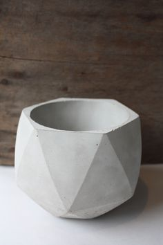 This hand-poured, concrete, geometric form boasts both functionality and style with simple lines and minimalist design. Currently our largest concrete item, this product can be used as a planter, candle holder, centrepiece, or decor (all on its own).This formis made fromraw concrete and sealed with food-grade sealant, ensuring multiple product uses. Each product is sanded by hand to give a smooth finish and backed with cork to protect your surfaces from scratches.When used as a…