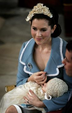 Crown Princess Mary of Denmark cradles her son and heir to the Danish throne Crown Prince Christian of Denmark