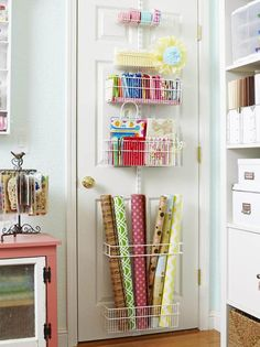 Over door hanging baskets are a great idea for storing a plethora of gift wrapping supplies - 15 Stunning Craft Storage Ideas You Will Want To Steal