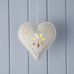 Cream Hanging Heart Tealight: Distressed cream hanging heart tea light holder. Pretty indoors or out and looks stunning when lit after dark.  - Painted metal - The distressed nature of this item is integral to its design and the exact finish may vary slightly from the image shown.