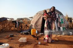 A Somalian refugee stands outside her home on the edge of the Ifo refugee camp which makes up part of the giant Dadaab refugee settlement on July 22, 2011 in Dadaab, Kenya. The refugee camp at Dadaab, located close to the Kenyan border with Somalia, was originally designed in the early 1990s to accommodate 90,000 people but the UN estimates over 4 times as many reside there. The ongoing civil war in Somalia and the worst drought to affect the Horn of Africa in six decades has resulted in an…