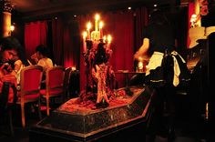 Vampire Café in the Ginza district. Gothic-Lolita waitresses offer you red wine, oops I mean, offer you some poor victim's blood as you take a seat in your private booth heavily draped with red curtains.