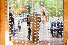 Just a few of the 1500 origami cranes strung into garlands ~ what a beautiful ceremony backdrop! Photography by kellanstudios.com