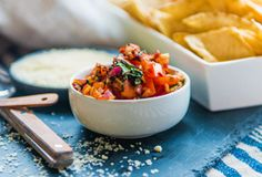 Charred Tomato Salsa. Fiery tomatoes create a unique and memorable salsa to top your tacos, burgers, or serve with chips.