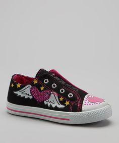 Sweet sneaks deserve a place on her feet. This fanciful pair will carry her throughout the day in style.Canvas upperMan-made soleImported