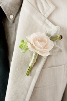 love this boutenier. so pretty and fresh I really like the silver thread around the base of the white rose