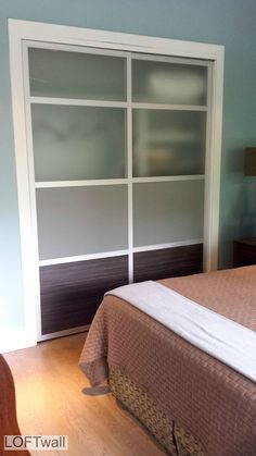 This is a Custom LOFTwall GLIDE with translucent, solid and wood panels.