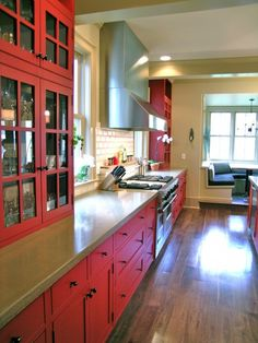 red cabinets with glass and stainless steel for a contemporary look