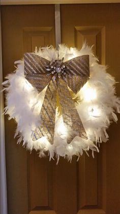 Lighted feather boa. Super easy handmade total cost $8 Can use feather boa's as lighted garland on the tree too! Christmas Fashion, Modern Christmas, Pink Christmas, Christmas Crafts, Christmas Tree, Wreath Crafts, Diy Wreath, Wreath Ideas, Feather Wreath