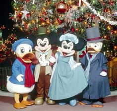 Donald Duck, Mickey Mouse, Minnie Mouse, and Scrooge McDuck are dressed in their holiday best!