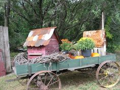 Old Farm Wagon...loaded down with fall treasures...grapevine, mums, pumpkins, &...large prim birdhouses.