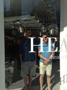 Anthony Dickens and Richard Fishenden standing in the window of Heal's new Queens Showrooom in Westbourne Grove, London. Admiring their work!