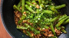 Enjoy this savory, colorful vegetable dish of green beans with garlic black bean sauce for a delicious Chinese American dinner from PBS Food.