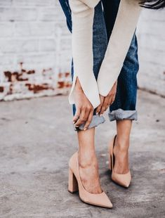 Cute blush heels with blue jeans.