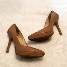 Nine West Nude Pumps Gorgeous shoes, small platform and stiletto heel. Light wear visible on bottoms of shoes and soles, but the shoe is overall in great shape. Nine West Shoes Heels