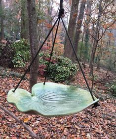 Feed your birds, or offer them some water in this unique pottery bird bath or feeder. A Hosta leaf from my garden was rolled into speckled stoneware clay, glazed in shades of green, and high-fired. It hangs 1' on sturdy parachute cord and a handmade brushed copper hook. Beautiful!
